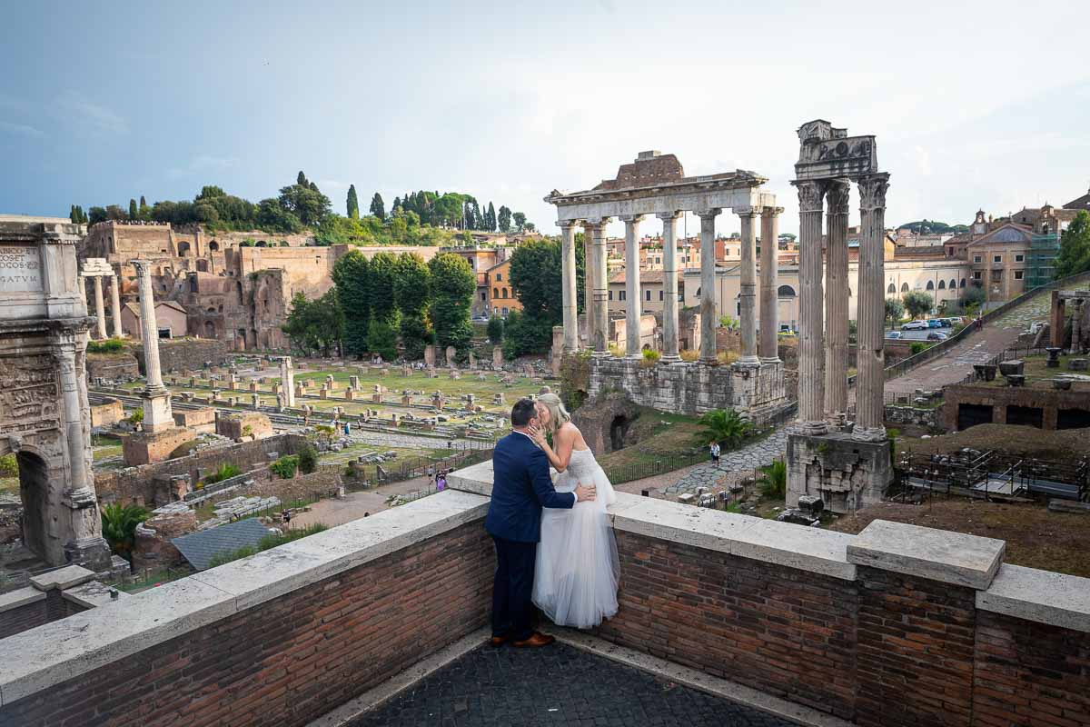 Posing together before the roman forum viewed from the above capitoline hill