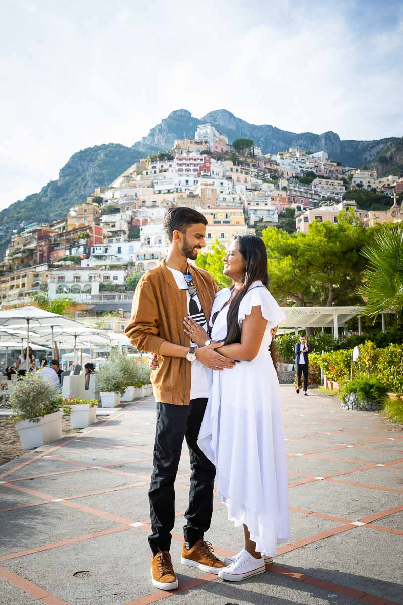 Engagement photoshoot portrait on the boardwalk of Positano with the hillside town in the background