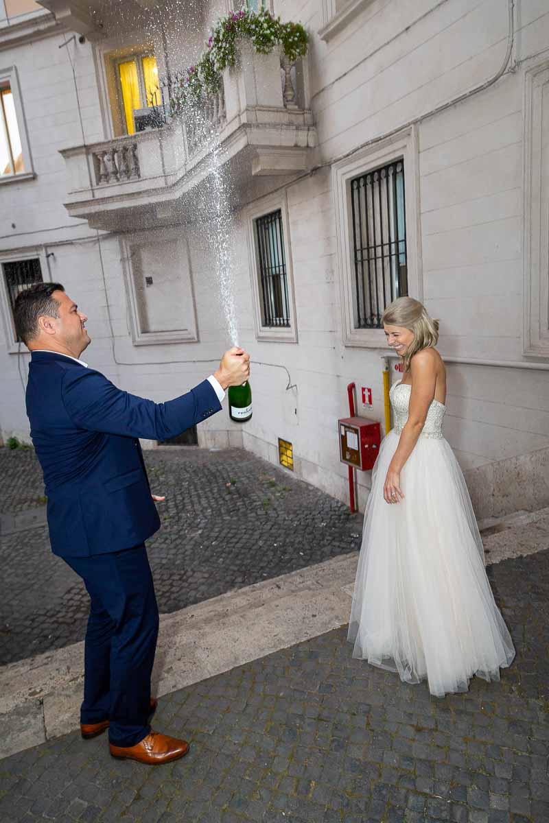 Celebrating by popping open a fresh Italian sparking wine bottle