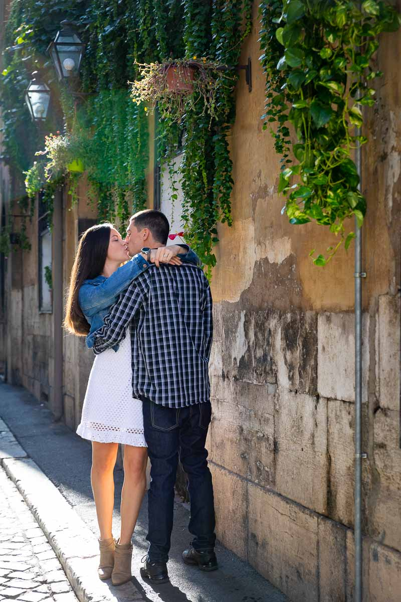 Kissing in the streets of Rome Italy during a photo shoot. Rome Engagement Pictures