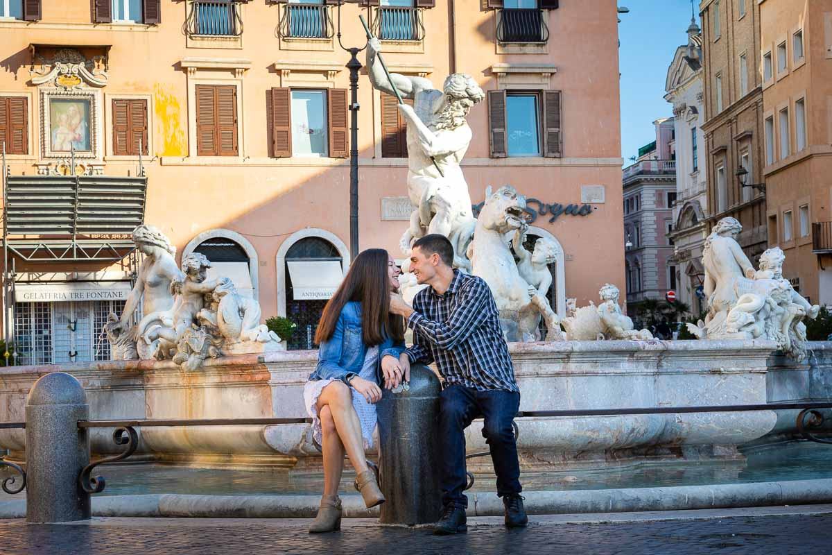 sitting down posing for a picture in Italy's Piazza Navona in the center of Rome