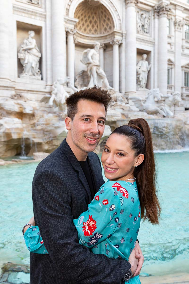 Couple portrait close together photographed in front of the Trevi fountain in Rome Italy
