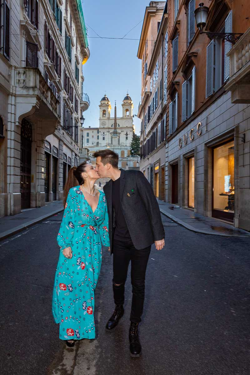 Couple walking together in Via Condotti during a photoshoot in Rome's Fashion district quarter