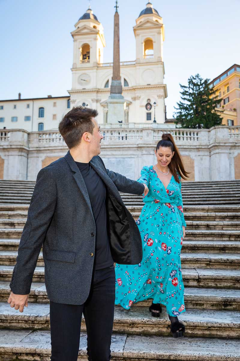 Walking down the Piazza di Spagna staircase while holding hands