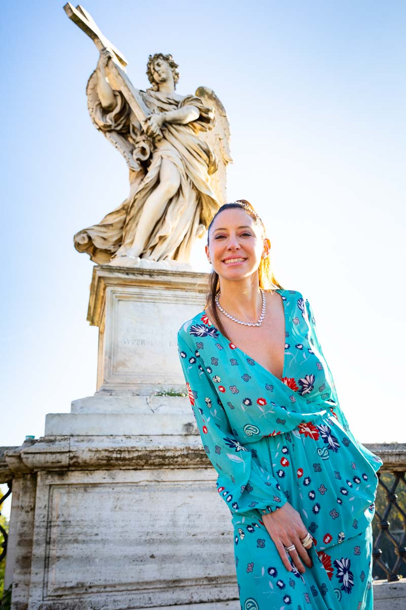 Fashion like woman portrait picture before a marble statue holding a cross