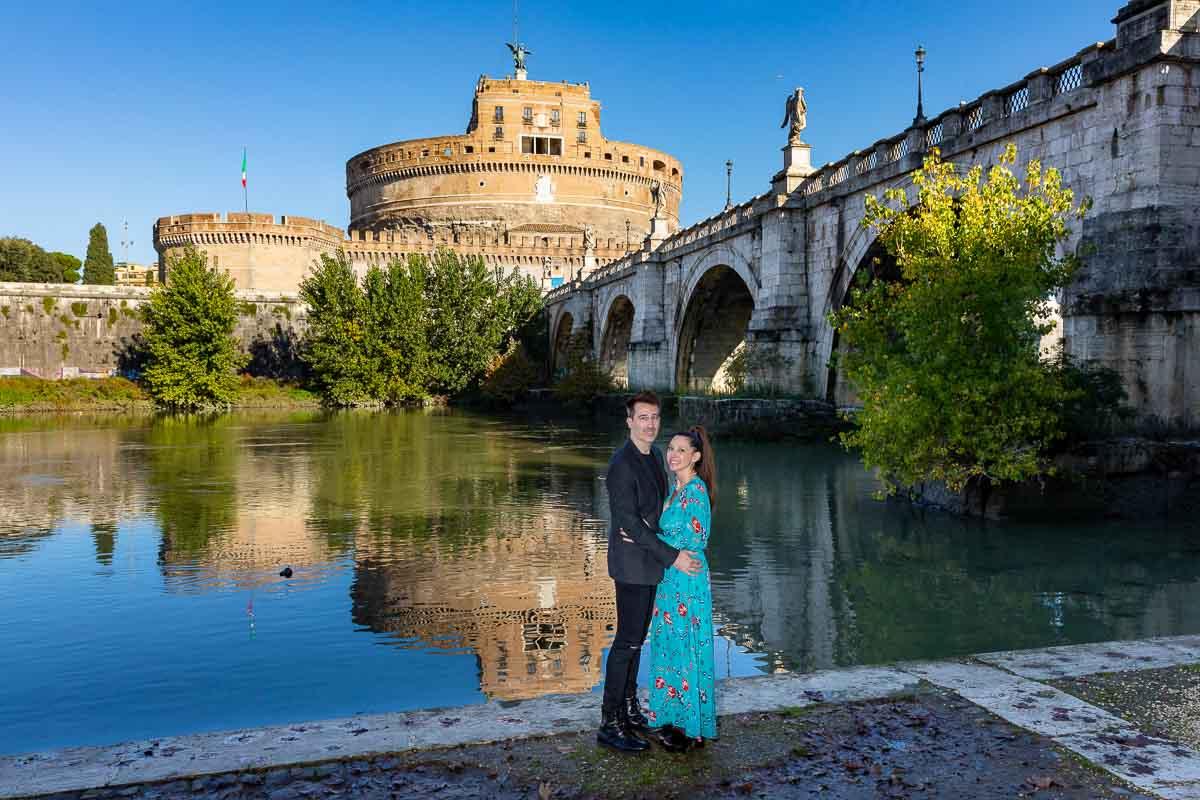 Couple portrait taken below the bridge at Castel Sant'Angelo next to the Tiber river