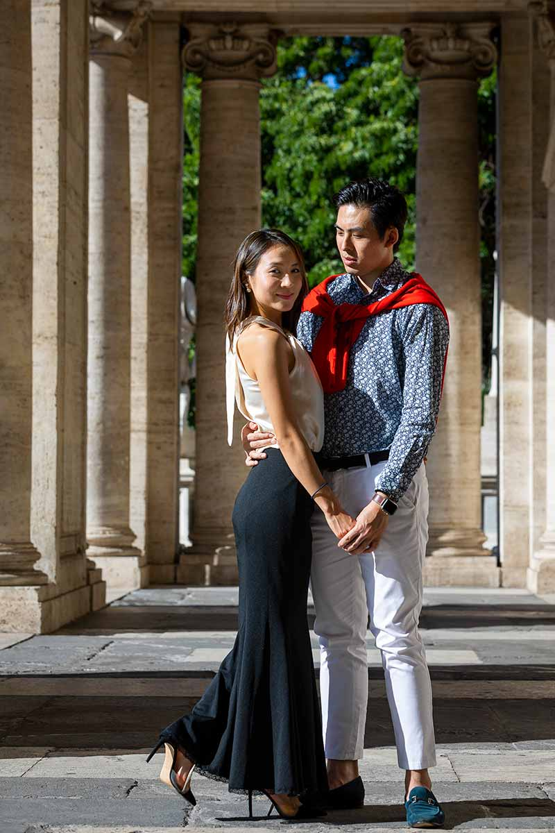 Posed image of a couple photographed under campidoglio portico with lead away columns