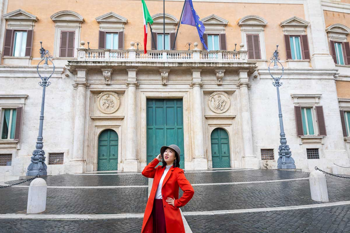 Standing in front of the Montecitorio building in Rome Italy taking fashionable pictures