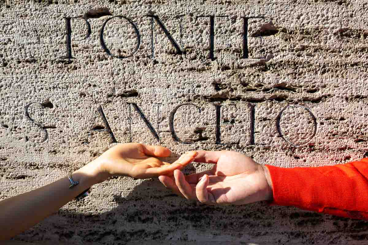Hands touching at Ponte S. Angelo castle