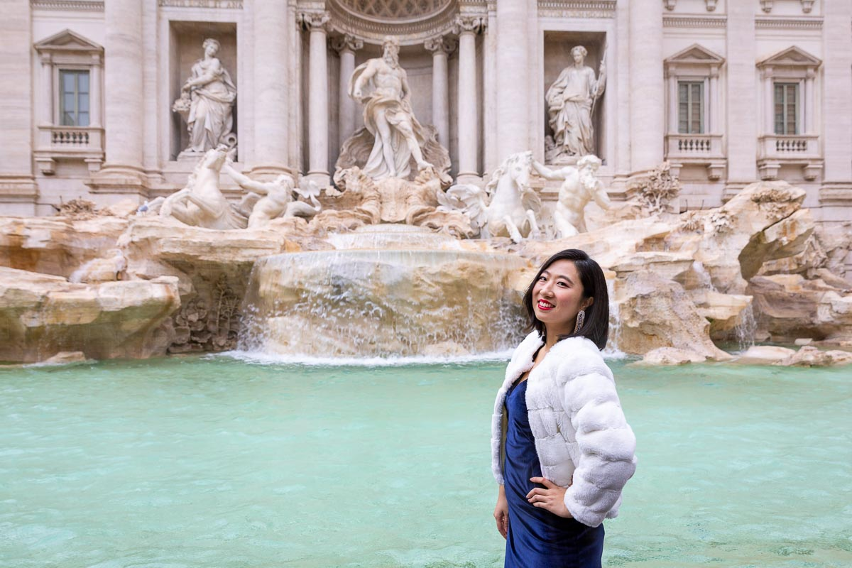 Trevi fountain Model pose taken during a Rome Fashion photoshoot