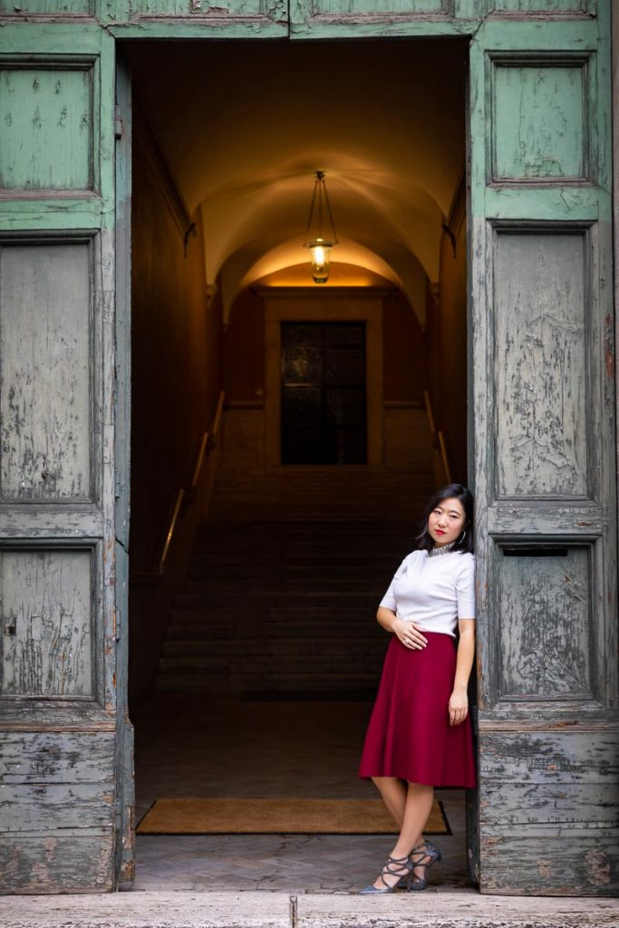 Standing underneath an ancient doorway female model portrait in nice natural light