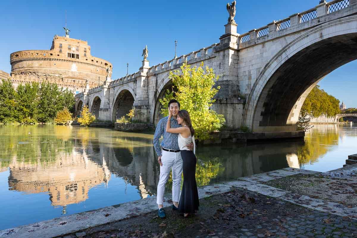 Standing underneath the Castel Sant'Angelo castle and bridge taking portrait photos