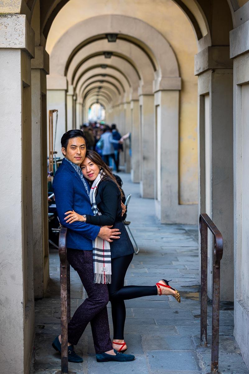 Couple posing shot taken underneath the lungarno porticos