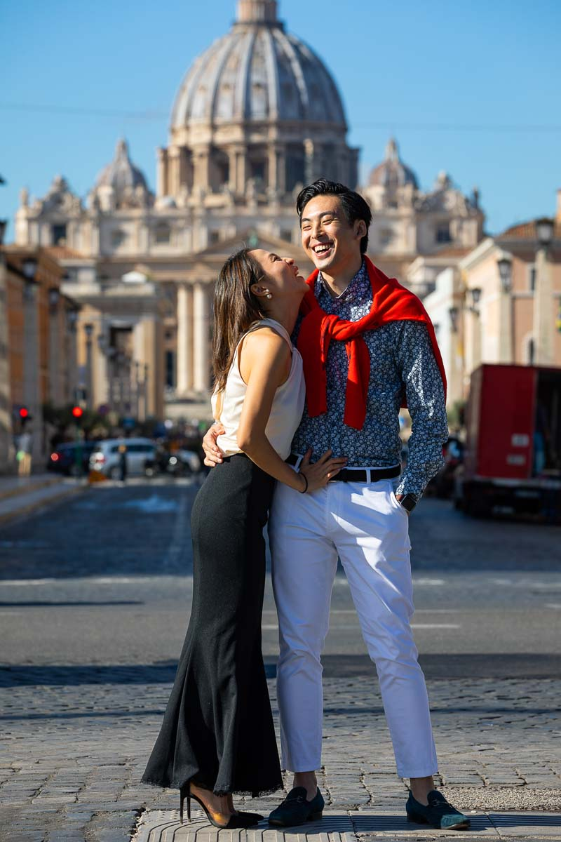 Engagement portrait taken before Saint Peter's cathedral dome in the far background