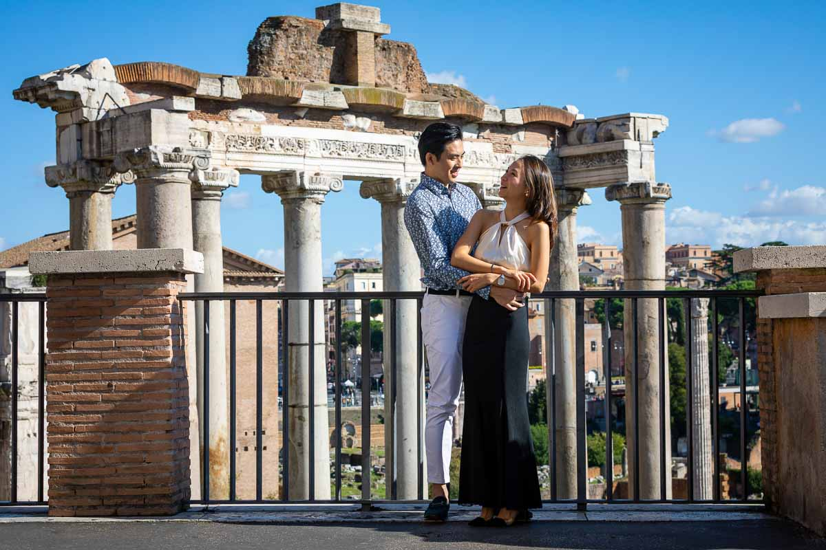 Together in Rome standing in front of the ancient Rome ruins of the imperial forum