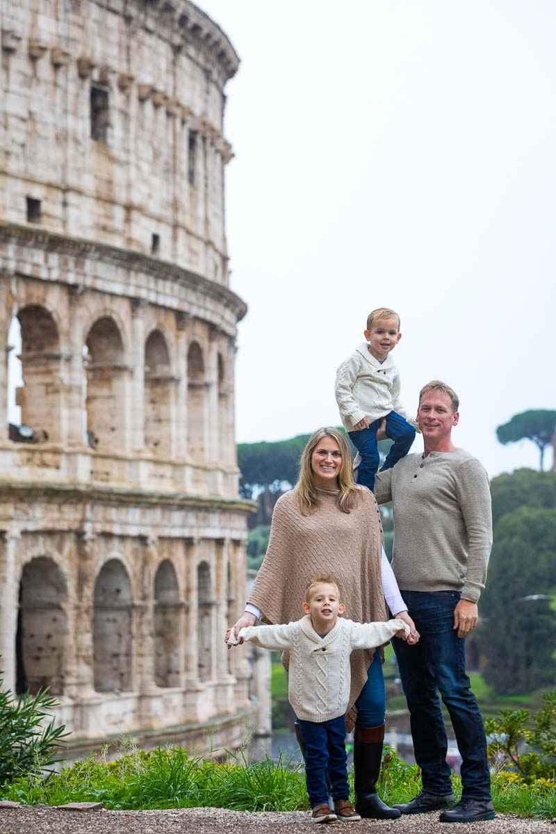 Family portrait picture taken at the Roman Colosseum