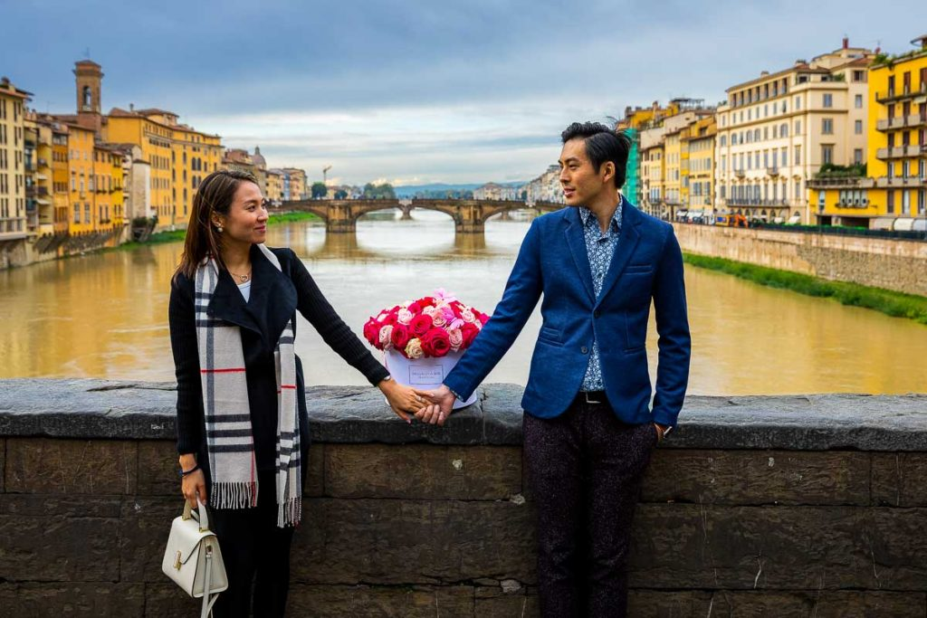 Engagement couple photoshoot in Florence over the Arno river in Italy