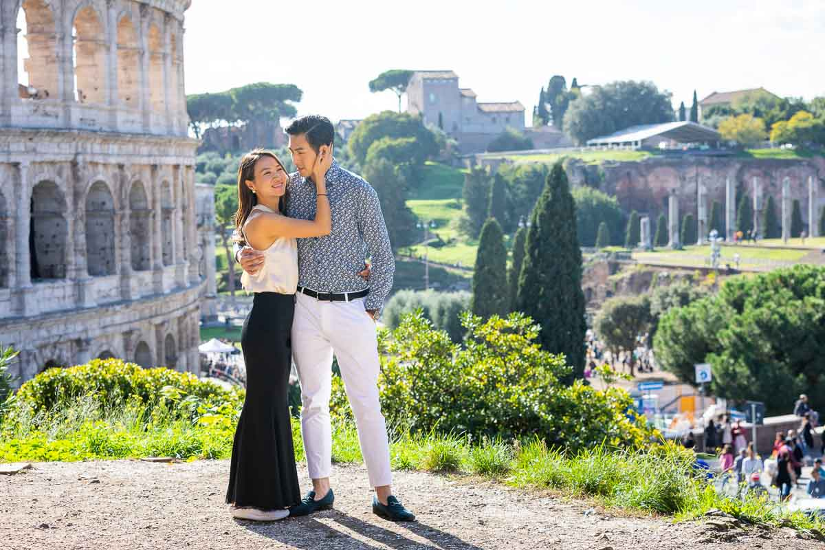 Together in Rome photo session at the Roman Colosseum overlooking the ancient monument as well as the roman forum