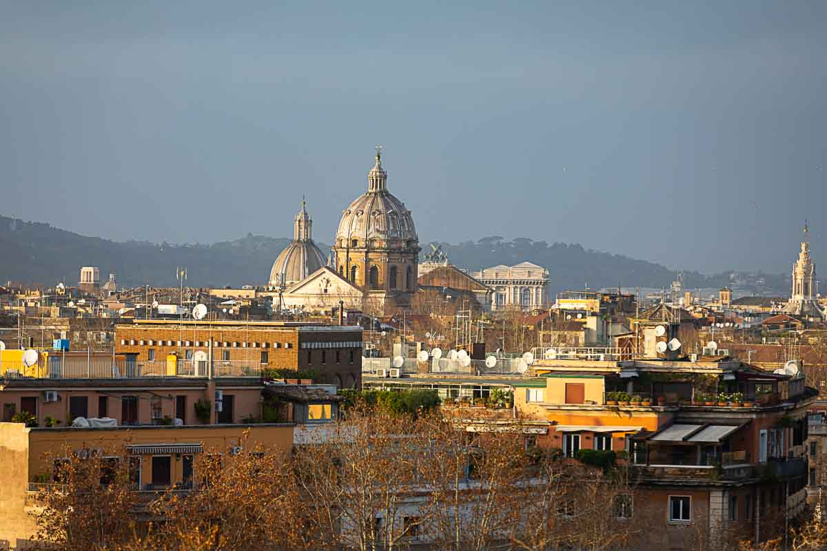The Rome city skyline photographed at sunset from the Aventine hill. Rome, Italy