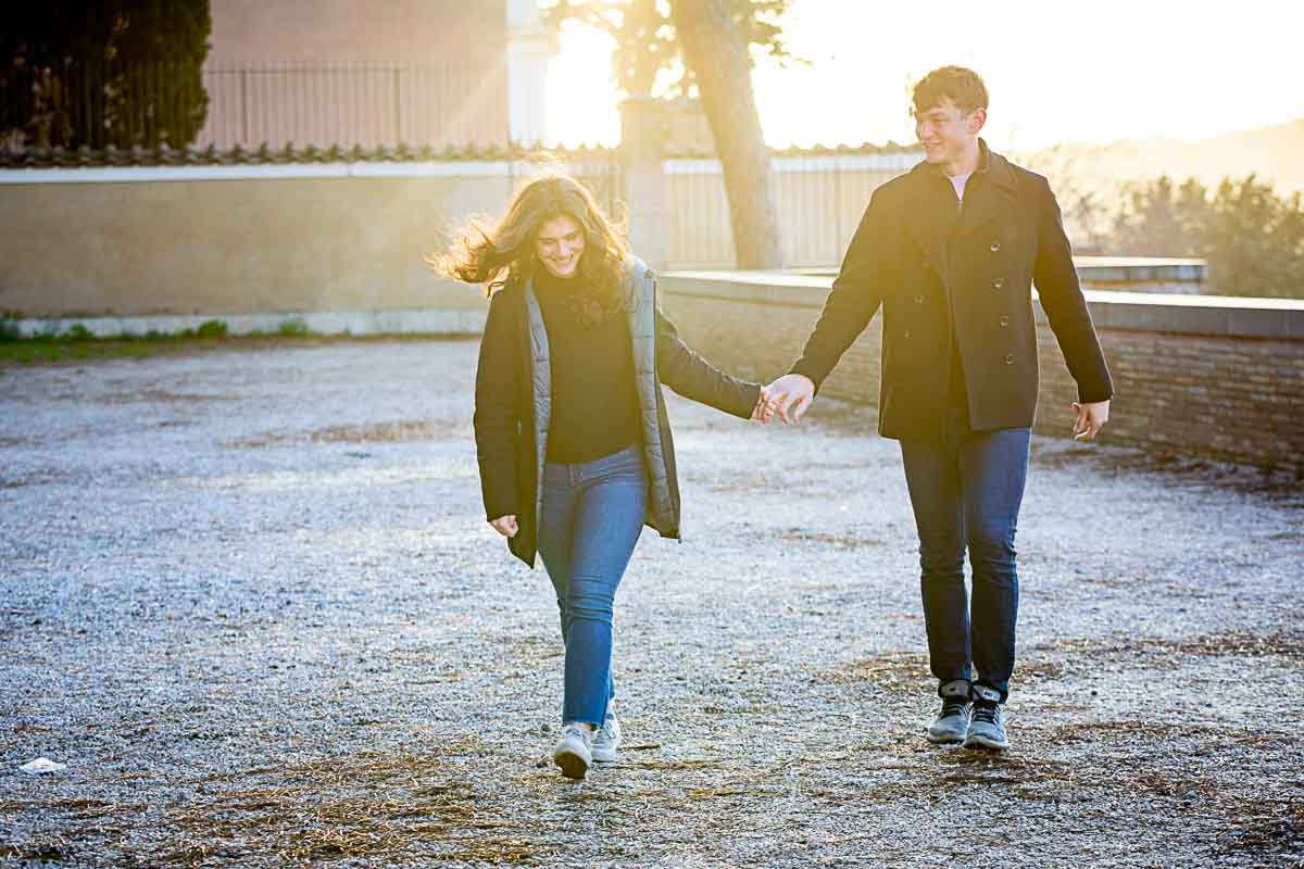 Walking together after a marriage proposal engagement session hand in hand