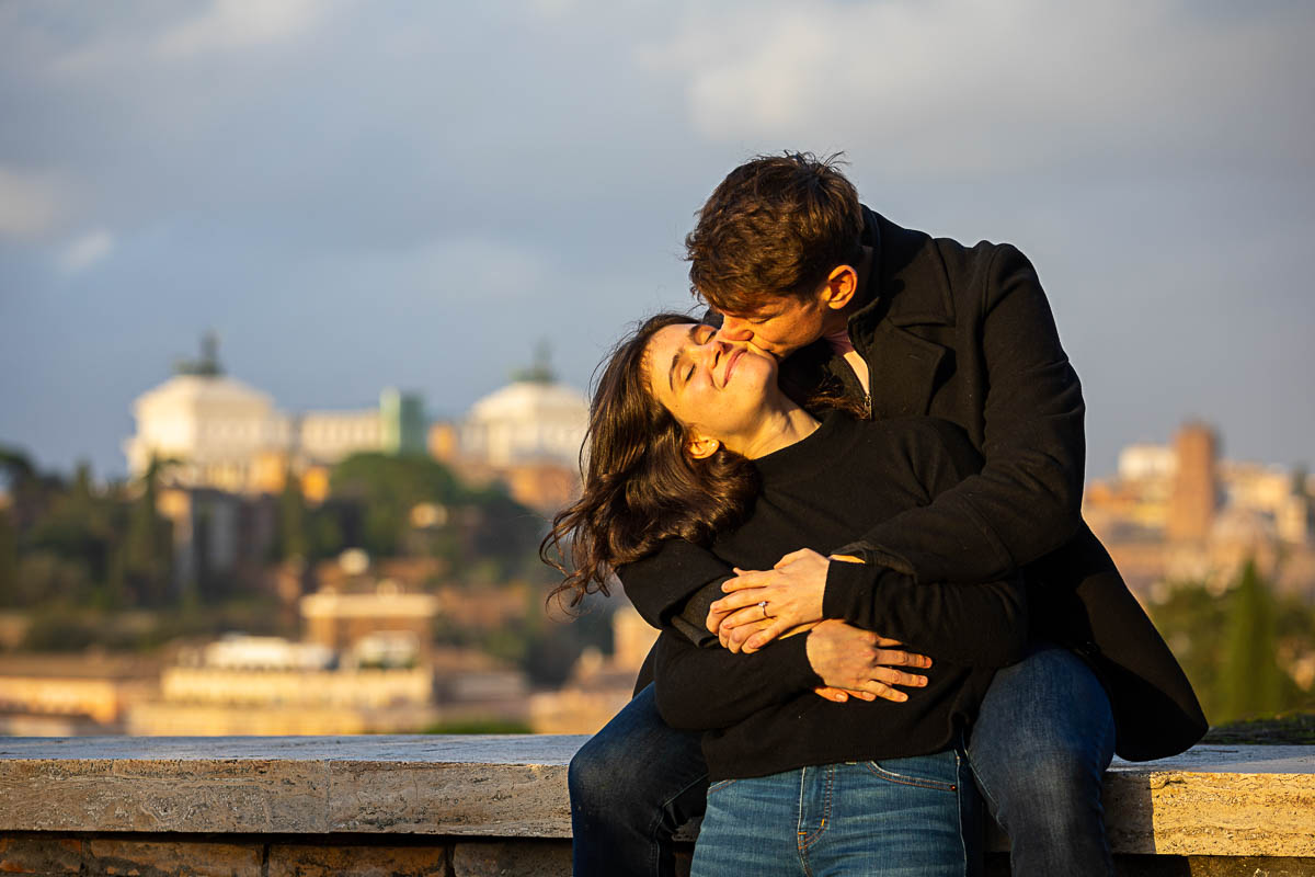 Kissing the cheek before the scenic view of the roman city