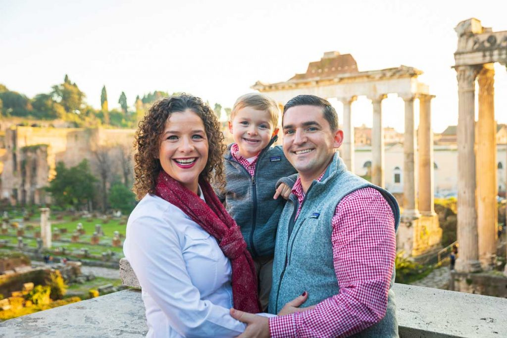 Closeup family photography in Rome using the ancient roman forum as backdrop
