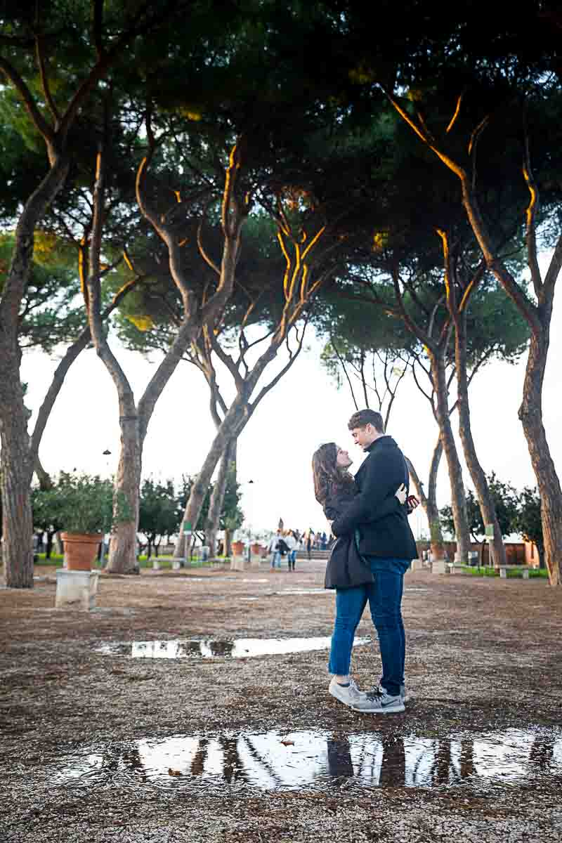 Standing posing for a photograph underneath the tall mediterranean pine trees found at the Orange garden