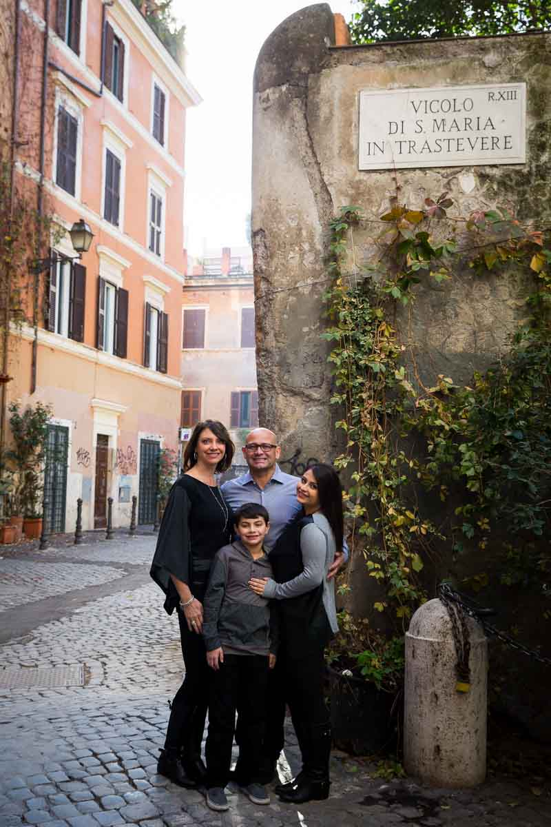 Family photography from Romeìs Trastevere quarter in very typical cobblestone alleyways
