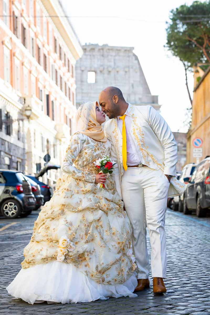 Newlyweds walking together in love. Rome, Italy. Colosseum in the far background