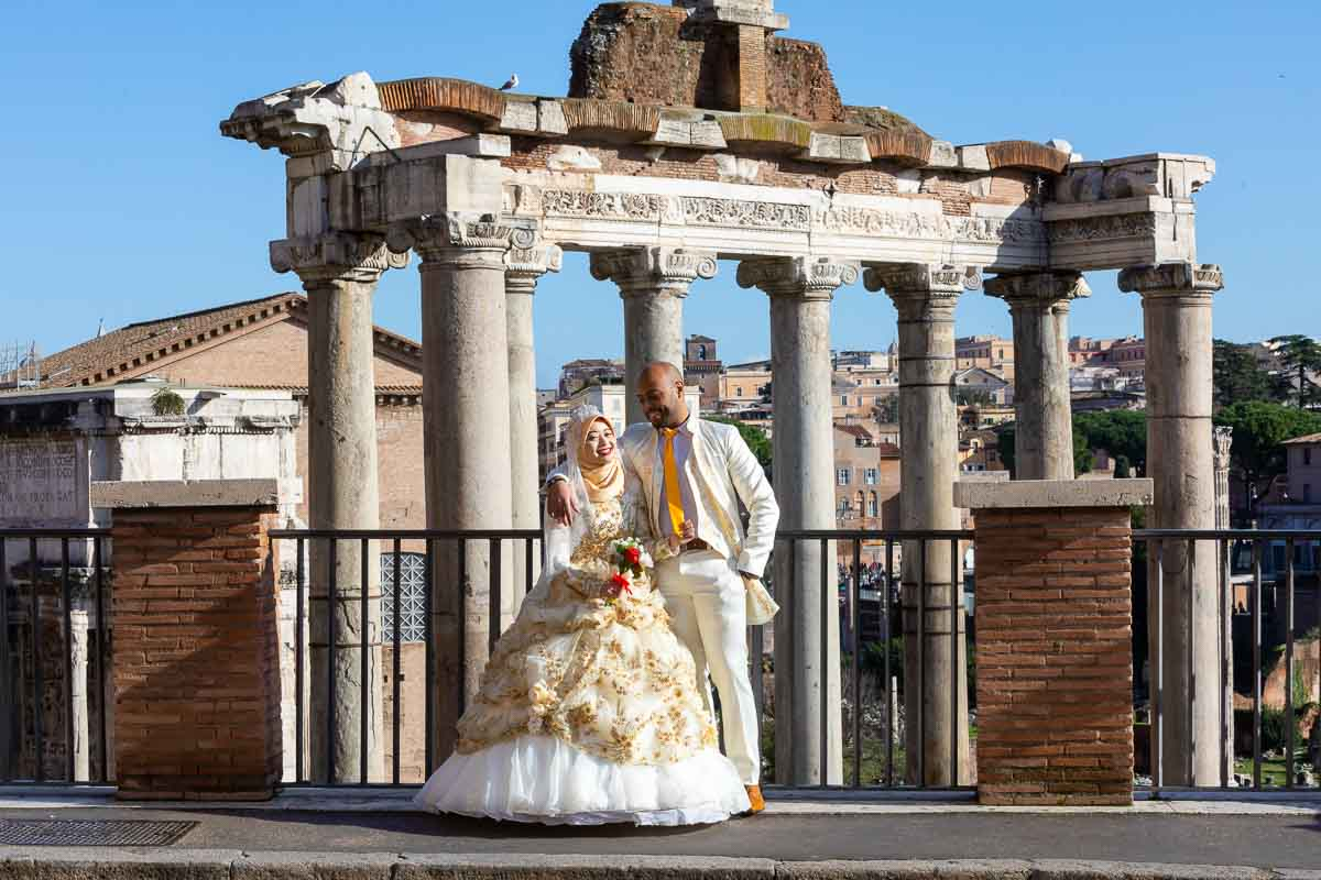 Groom and bride posing in front of the Roman Forum. Rome Italy