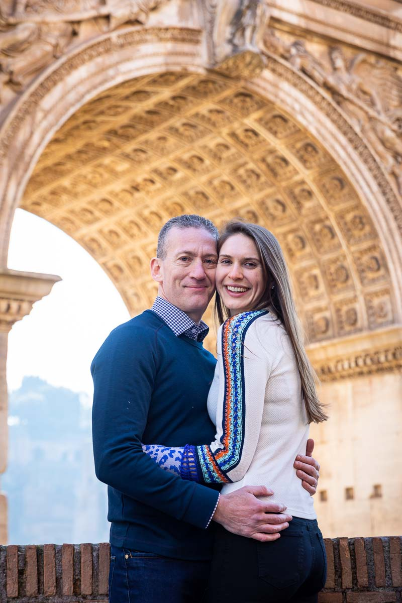 Couple close up honeymoon photo portrait taken underneath a roman arch