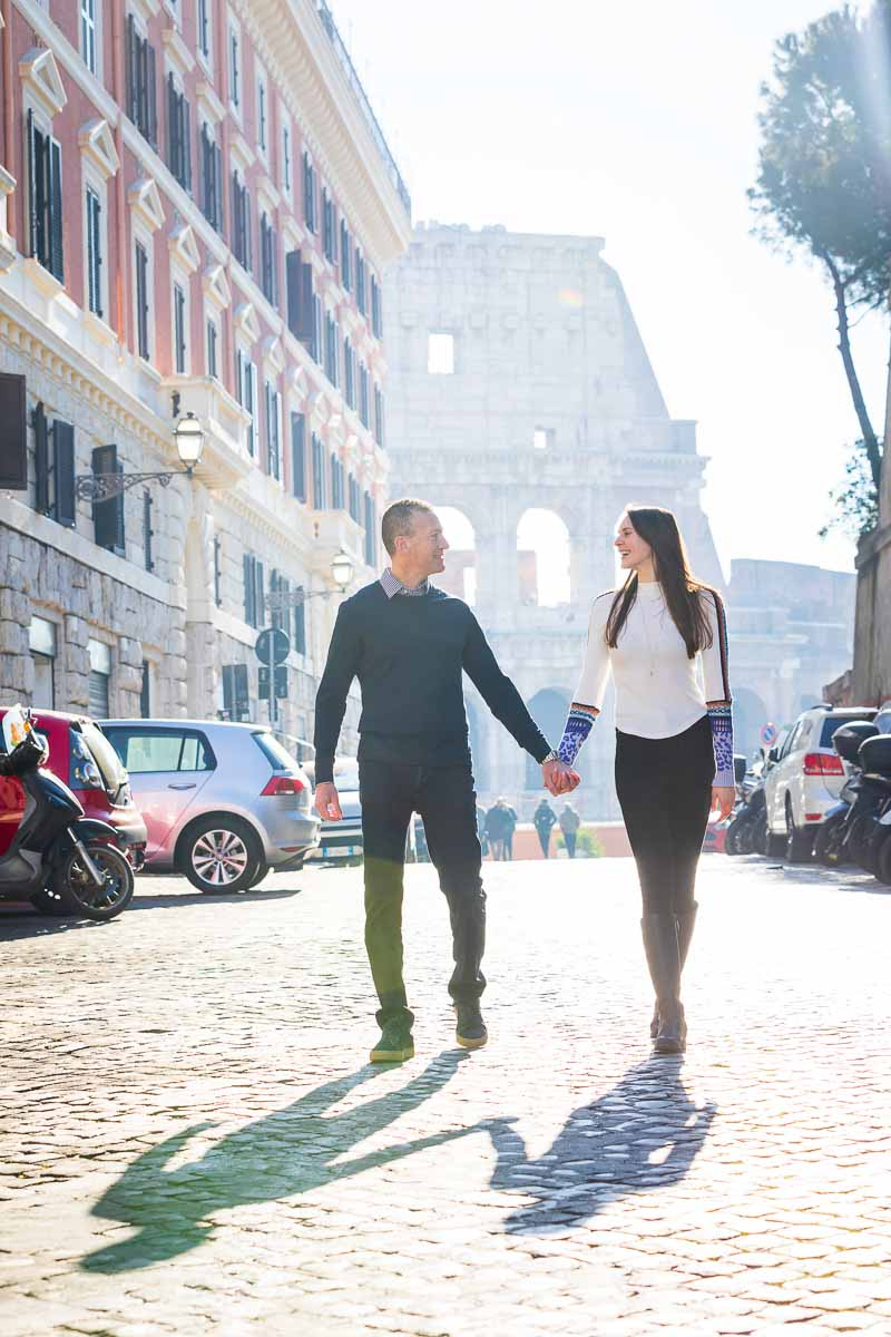 Walking together holding each other's hand with the iconic roman colosseum in the background