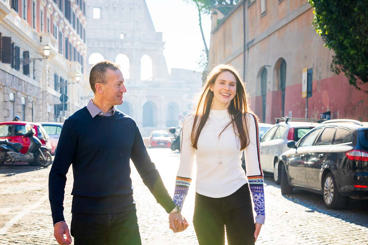 Close up couple portrait while walking together before the Coliseum