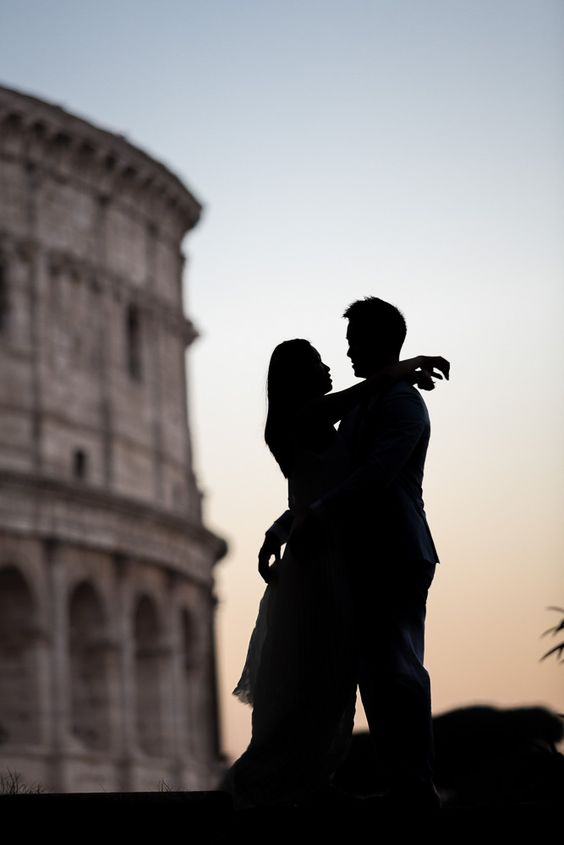 Couple photographed at dusk at the Roman Colosseum during a couple photo shoot in the Eternal city of Rome Italy