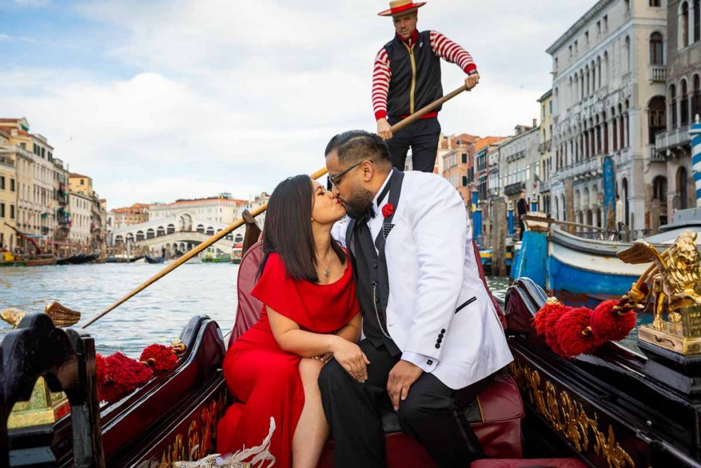 Kissing in Venice after accepting marriage proposal on a gondola ride