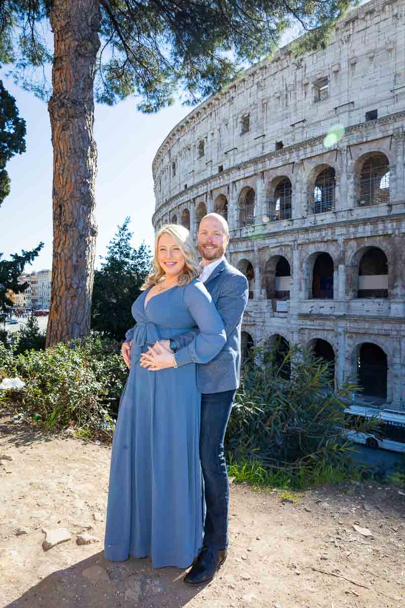 Posed couple portrait in front of the Coliseum in central Rome