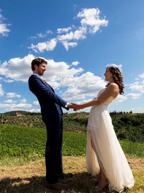 Newlywed holding hands together during a wedding photo shoot in Tuscany Italy