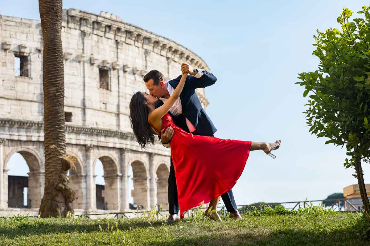 Couple dancing pose photographed during a Photo Shoot in Rome Italy near the Colosseum