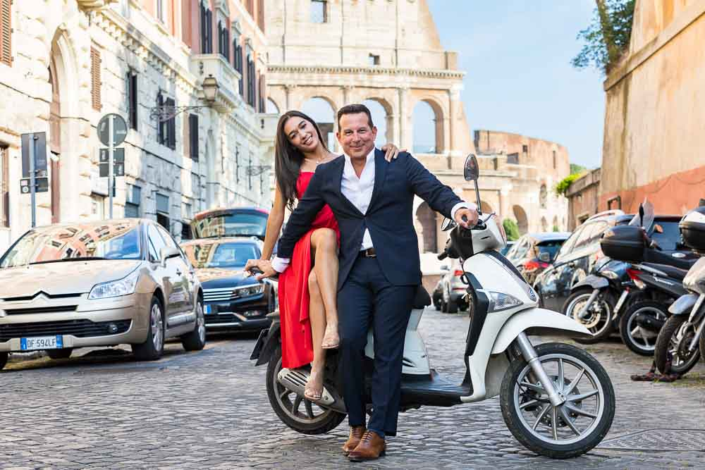 Sitting down on an Italian white scooter during a photo session