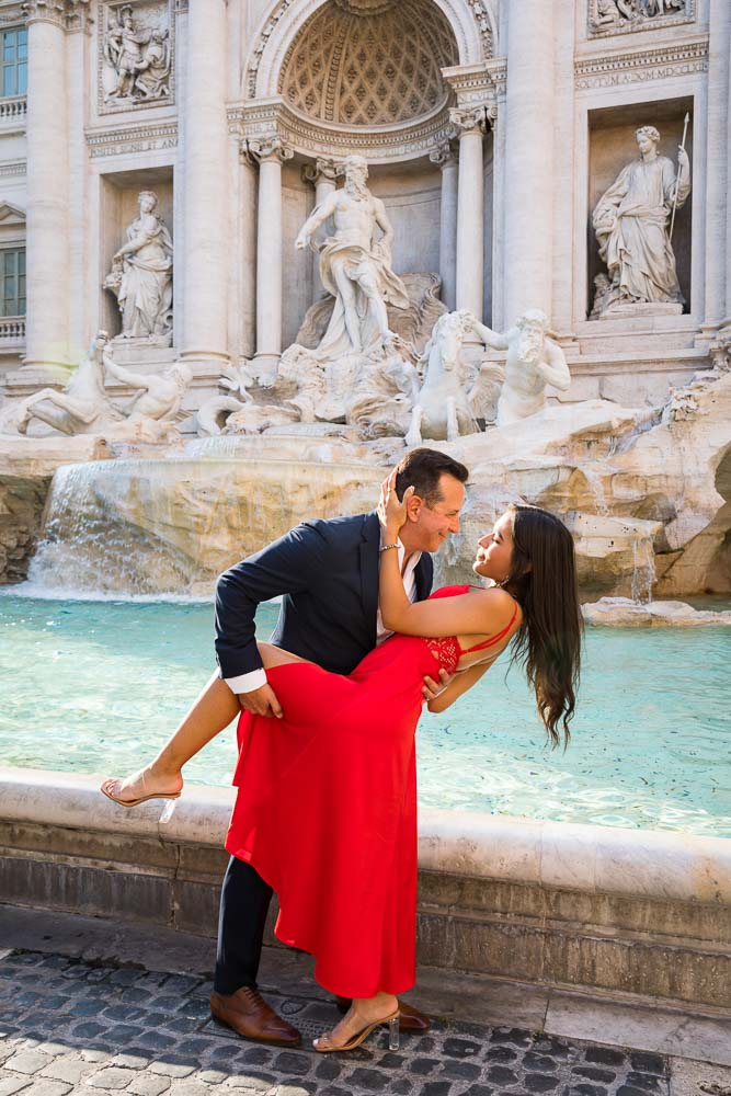 Posing in front of the Trevi fountain during a photography session