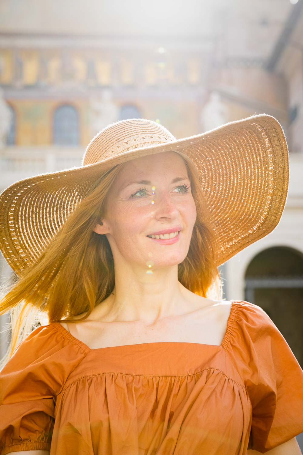 Female moedl portrait in the sun with a straw hat