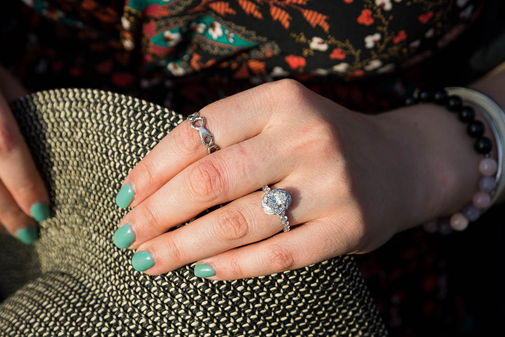 Close up image of the engagement ring wore on the hand