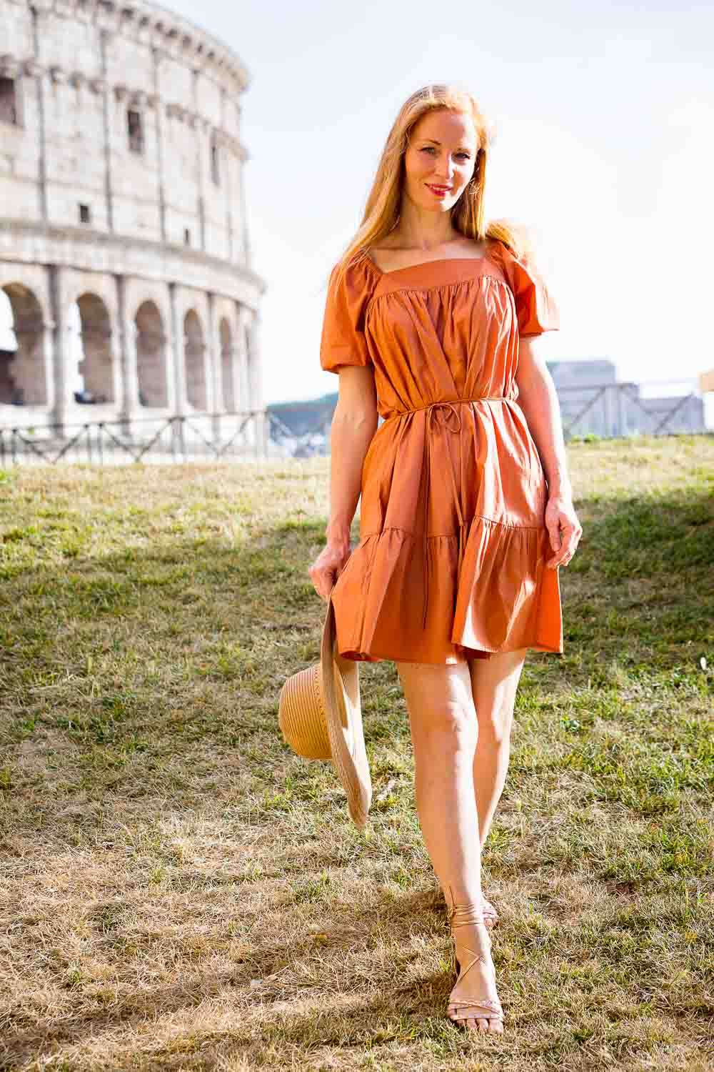 Strolling down in front of the Coliseum in color photography