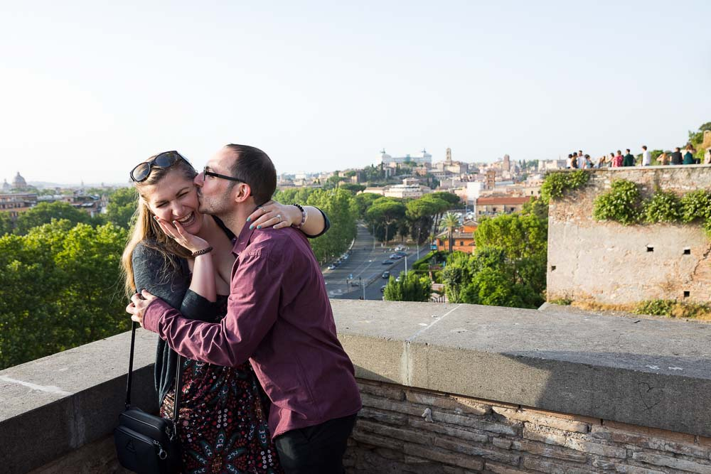 Couple kissing after engagement to be married in the eternal city