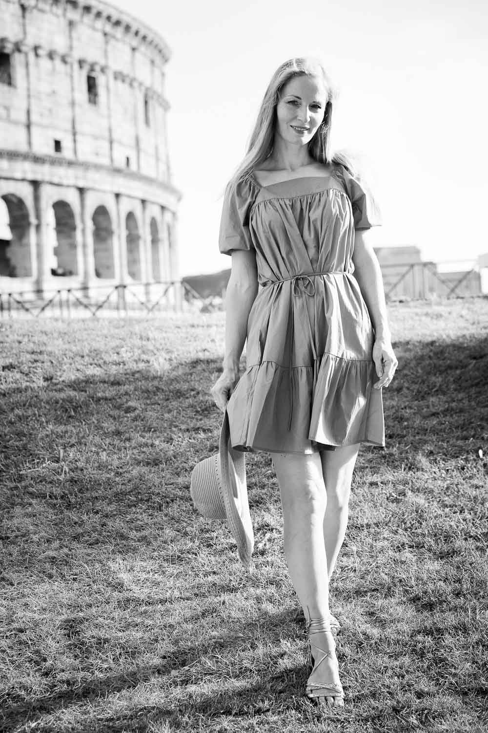 Strolling down in front of the Coliseum in black and whitephotography