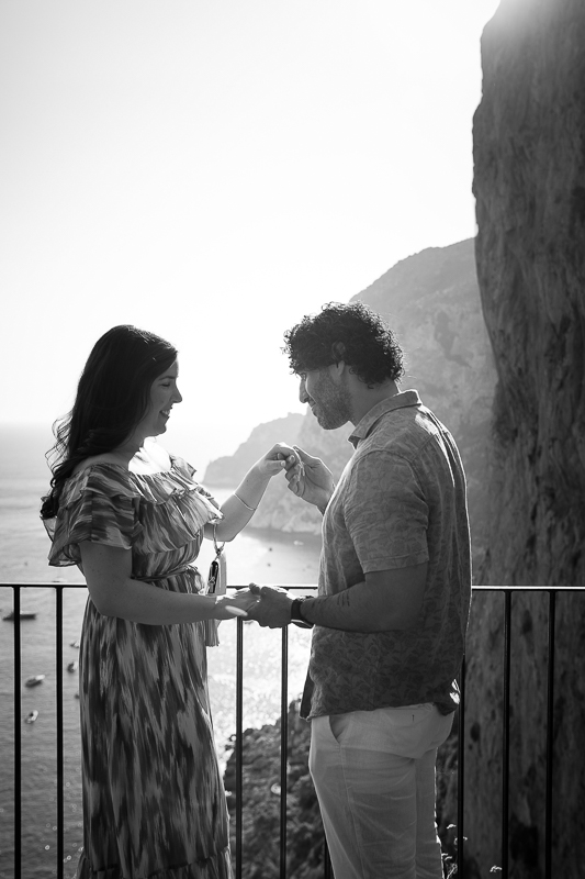 Chivalry moment photographed in black and white with beautiful seaside views
