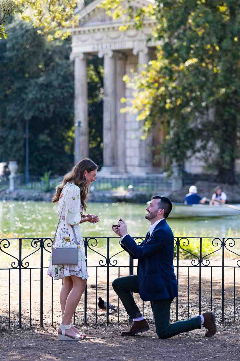 Knee down wedding proposal in Rome photographed at the Villa Borghese park in Rome Italy