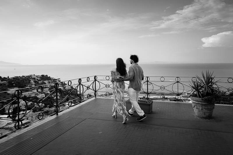 Walking together in black and white photos reaching the terrace balcony
