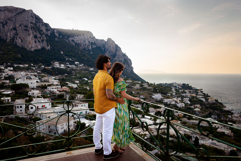Looking at the sunset view together over Capri island