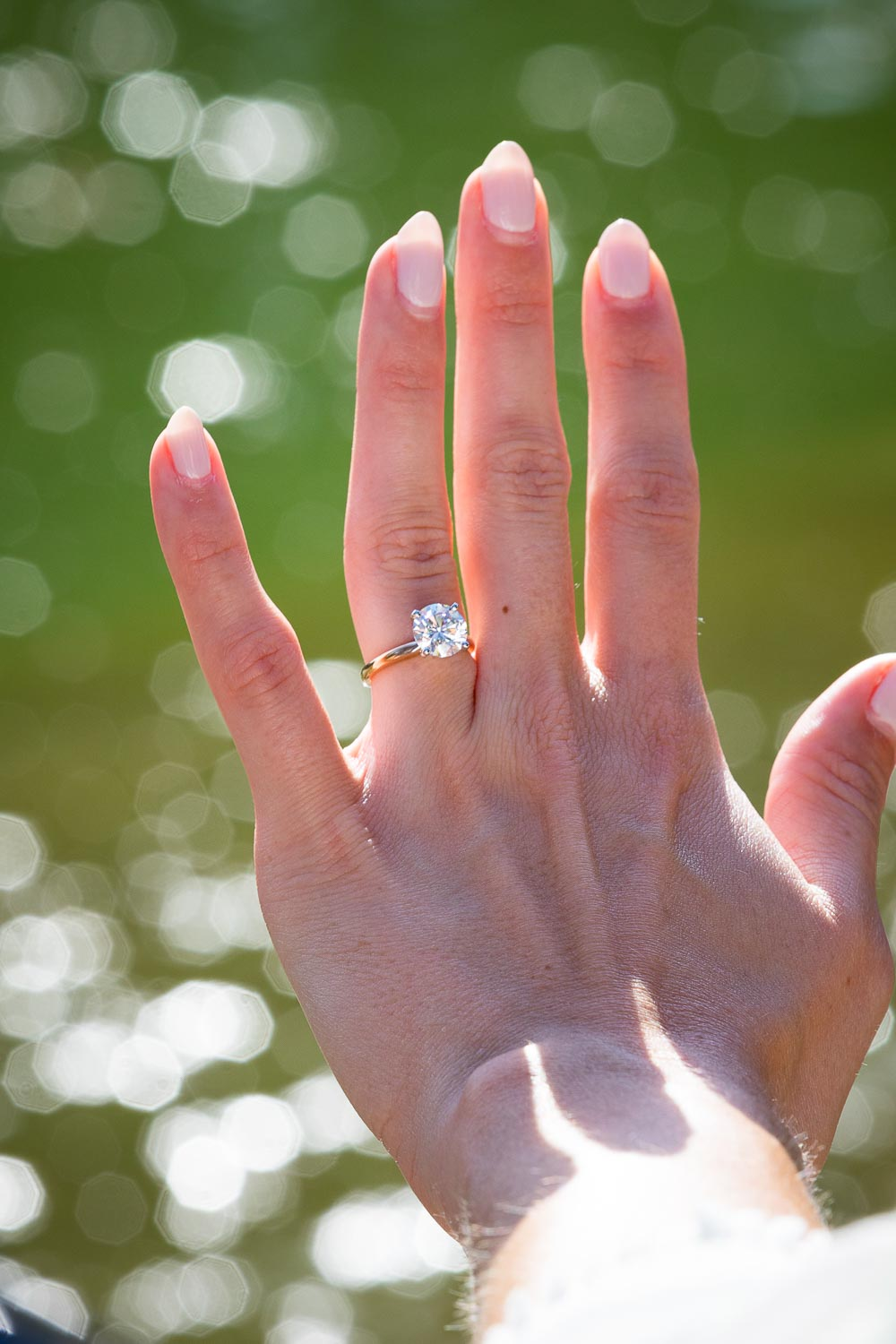 Close up the engagement ring wore on the hand